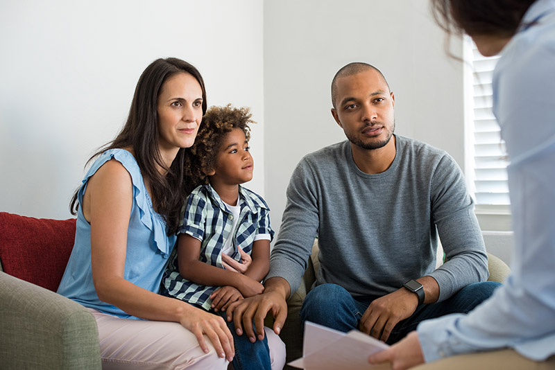 Photo of family talking with a counselor